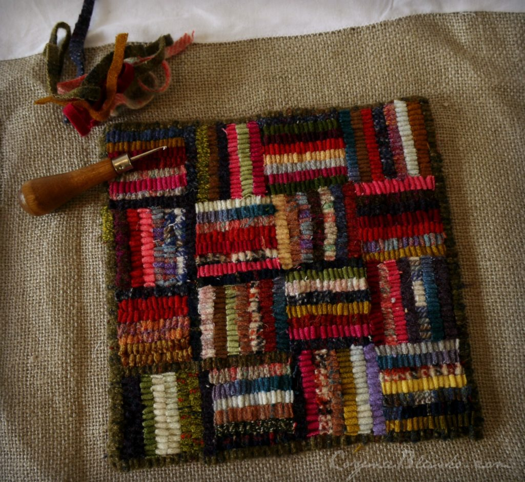 Hit and Miss table mat with hook, in progress.